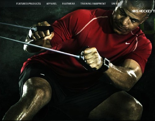 Screenshot shows Nike-shirted, sweat-caked Jarome Iginla leaning back and straining against cable pulls
