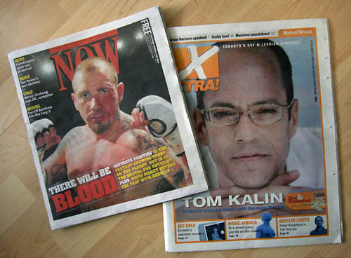Cover of 'Now' featuring bloodied, tattooed, shirtless figher holding up two fists; cover of 'Xtra' showing squinting, four-eyed Tom Kalin