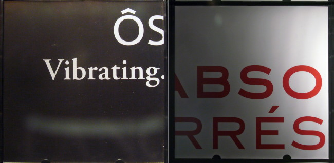 Two sign fragments side by side: ÔS Vibrating. in white on brown and BSO RRÉS in red on white