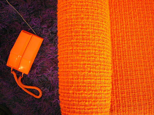Orange Contempra phone and chair