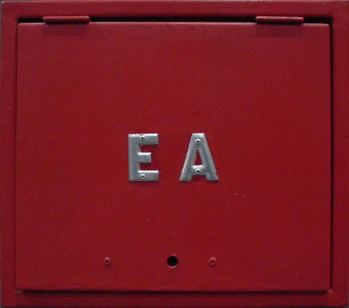 Red utility door with silver letters 'EA'