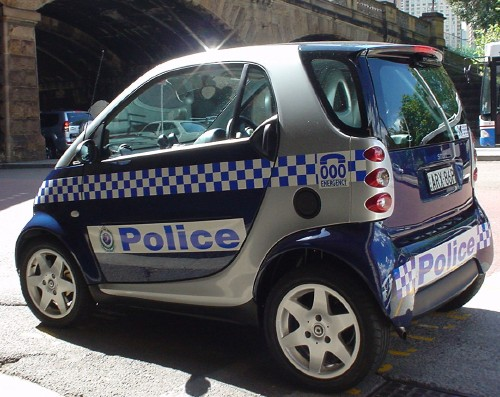 Smart Fourtwo in full blue-and-silver-checked police livery