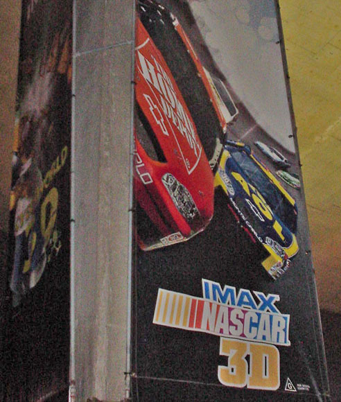 Tall banner shows race cars and 'Imax NASCAR 3D'