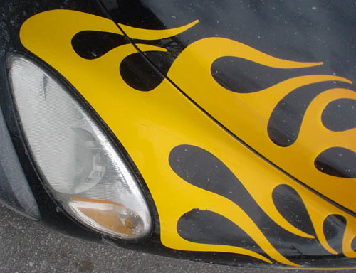 Yellow flame decals spread inward from headlamp on black PT Cruiser
