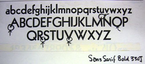 Marked-up type specimen is hand-labelled Sans Serif Bold 330J