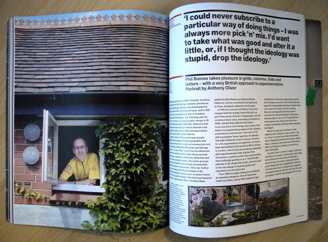 One one side of a double-page spread, bald Phil Baines peeks out of window wearing cycling jersey