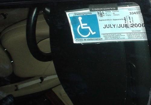 Disabled parking permit under windscreen