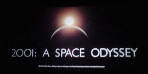Title card shows a star eclipsing a penumbra and the words  '2001: A Space Odyssey'