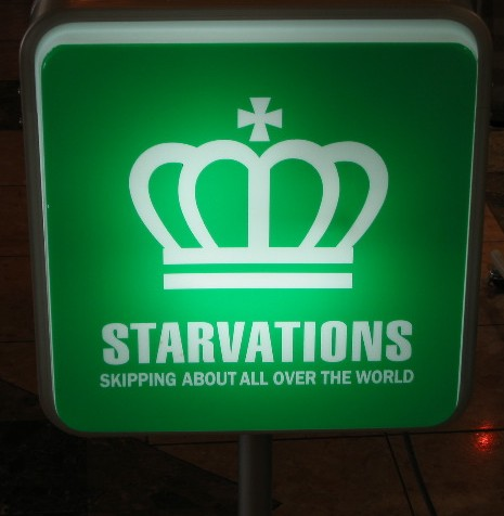 Green sign with white crown and the legend 'Starvations: Skipping About All Over the World'