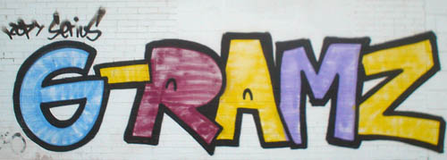 Graffiti on wall reads [rotated schwa]-RAMZ