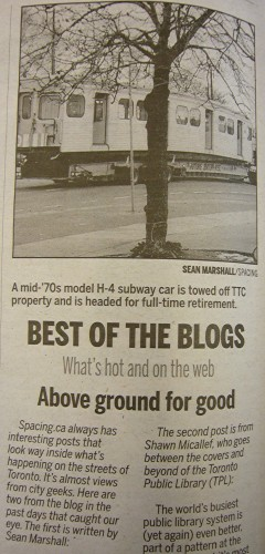 News clipping and photo with headline 'Above ground for good'