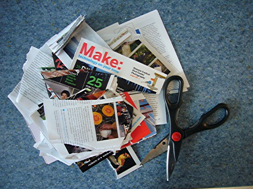 """Shredded pages (with """"Make' clearly visible) alongside scissors"""