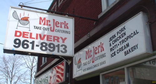 Sign reads Mr. Jerk TAKE-OUT CATERING in hand-drawn Helvetica and Hobo, with a long descender on the J