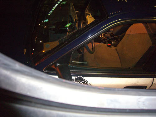Metal window border obscures retroreflective paint on door of car, including ORONTO shield