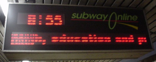 Subway time sign and crawling news ticker has missing bands of pixels