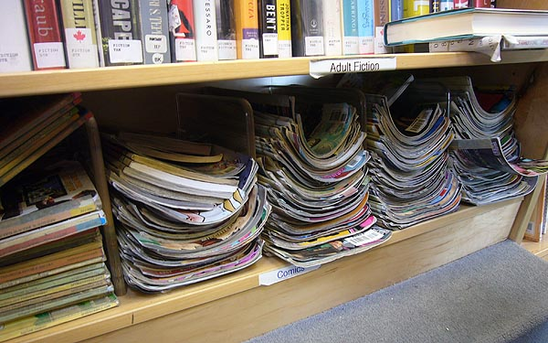 Stacks of comic books on a shelf