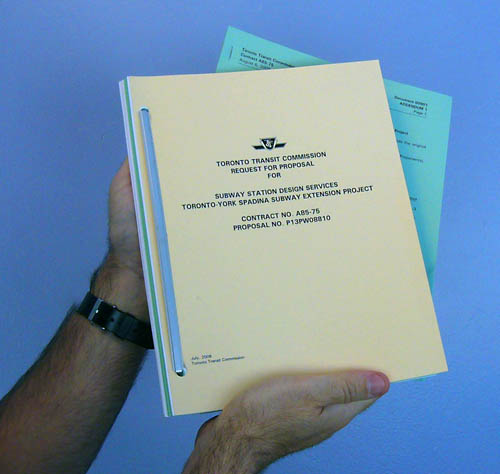 Me holding two bound documents