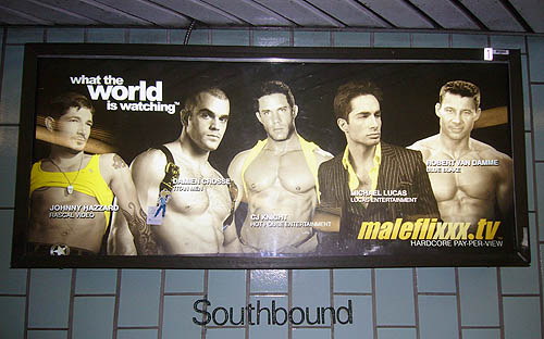 Illuminated ad for Maleflixxx shows scantily-clad male models. It sits above a Soutbound designation on a green tiled wall