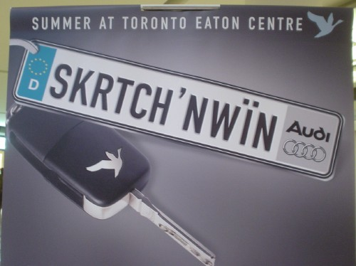 Poster has headline SUMMER AT TORONTO EATON CENTRE and shows an Audi key fob reading SKRTCH'NWÏN