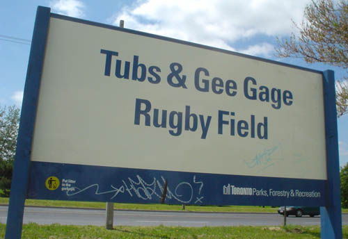 Sign reads Tubs & Gee Gage Rugby Field