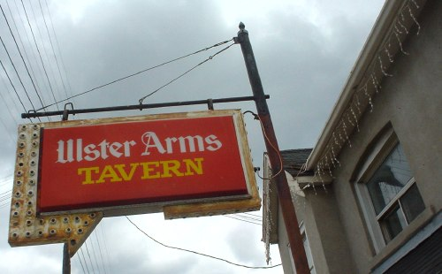 Ulster Arms Tavern sign, with surrounding arrow whose light bulbs are in disrepair