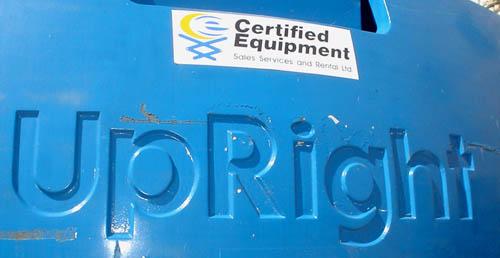 Embossed logo on crane reads UpRight in sansserif font