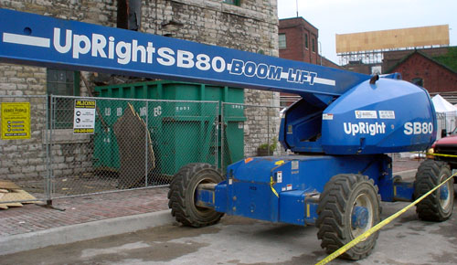 Blue crane is emblazoned UpRight SB80 BOOM LIFT, in part, in sansserif type with high x-height and thick circular strokes
