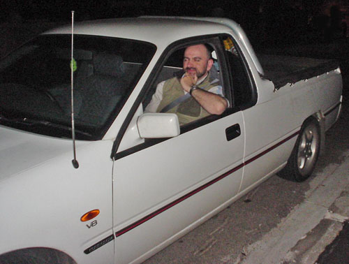 Me in passenger seat of white two-door pickup