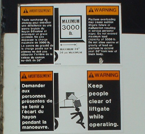 Close-up of four warning labels in English and French (ten in enlarged photo)