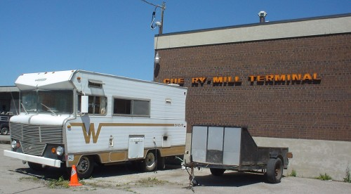 Elderly Winnebago Brave motorhome parked outside dilapidated Cherry Mill Terminal
