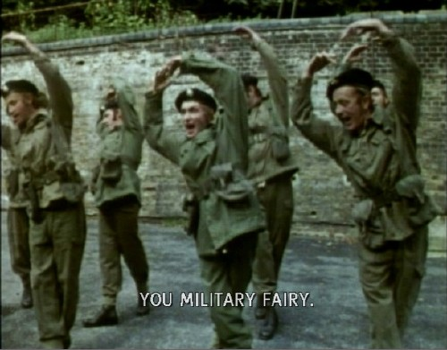 Uniformed soldiers do a piroette as caption reads YOU MILITARY FAIRY.