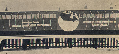 Old billboard shows a globe featuring only Canada radiating sound waves: CANADA SPEAKS TO THE WORLD FROM HERE