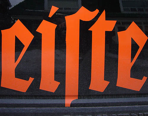 Orange letters on glossy background read eiſte