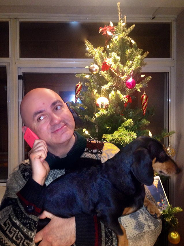 Me and Saatchi before the Christmas tree. I'm holding the phone upside down