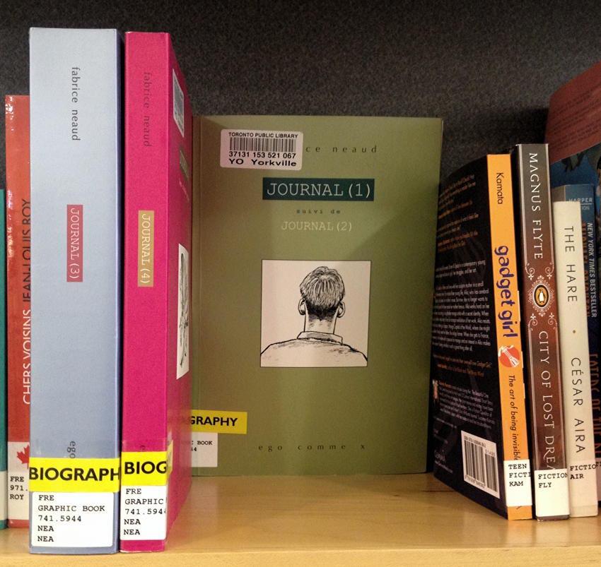 Neaud books on library shelf