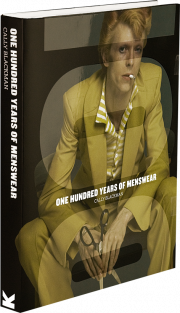 Cover showing David Bowie in ochre-coloured suite