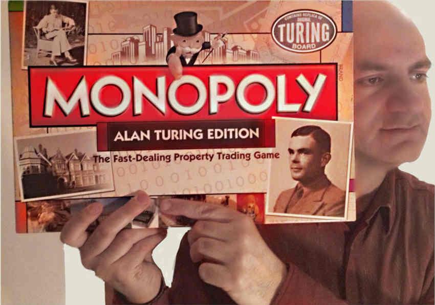 Me holding Alan Turing Monopoly set