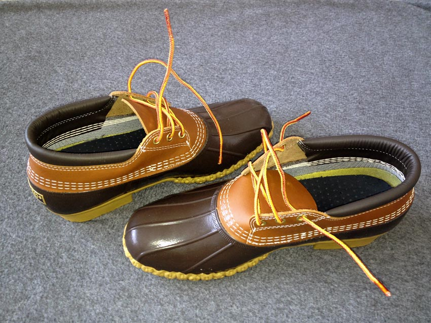 Brand-new L.L. Bean duckboots with stiff orangeish laces pointing in random directions