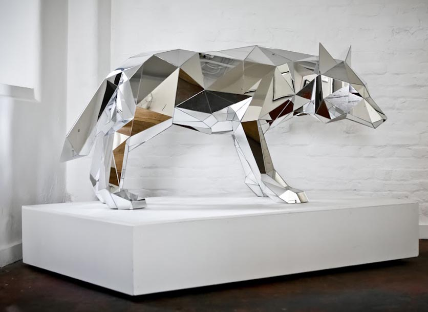 Wolf made from tiny contiguous faceted mirrors