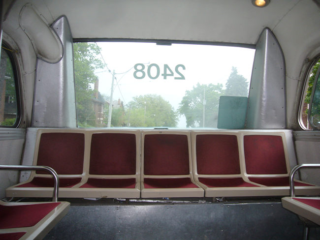 Five-across seating at rear window of bus 2408
