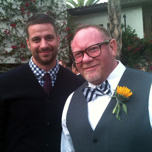 Chris in tie and cardigan, Marv in bowtie with corsage on veston