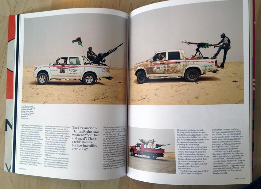Double-page spread showing African warriors posing with  weapons mounted in the cargo bays of their pickup trucks
