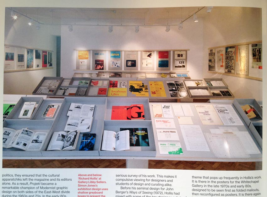 Photo showing books and other objects under glass on angled display tables