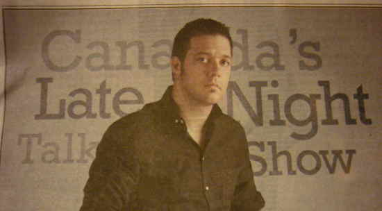 Strombo in front of field reading Canada's Late Night Talk Show