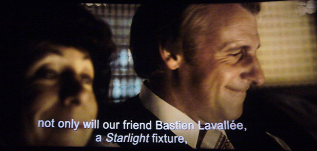 Arial subtitle on film, with italics
