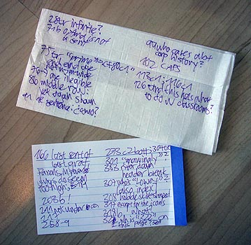 Handwritten notes on napkin and index card