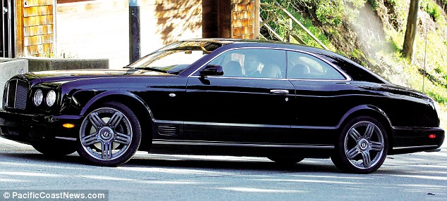 Vaguely unidentifiable man stares out of Bentley Brooklands driver's-side window at us