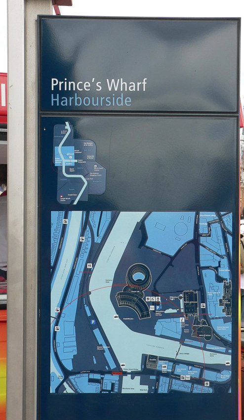 Tall rectangular sign reading Prince's Wharf Harbourside at top, with a small map and a large overhead diagram