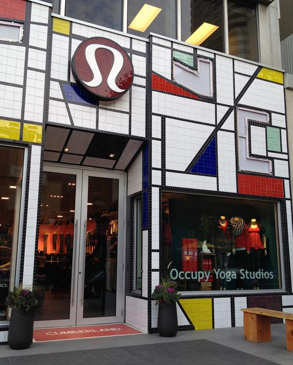 Lululemon store with Occupy Yoga Studios on front vitrine