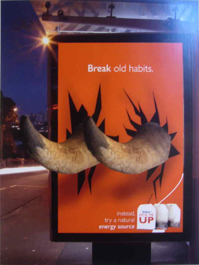 Two giant horns stick out of a transit billboard at an angle. Hed: Break old habits